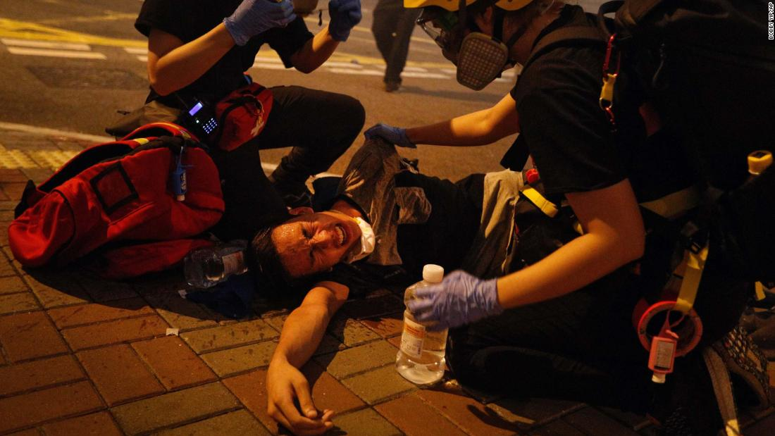 Medical workers help a protester affected by tear gas on July 21.