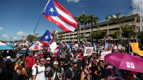 People join a rally against Puerto Rico Governor Ricardo Rossello demanding his resignation in San Juan, Puerto Rico Monday, July 22, 2019.
