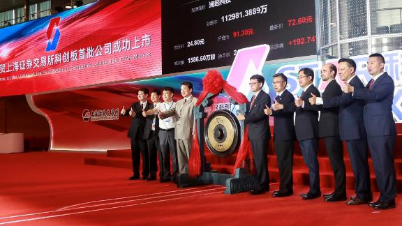 People attend an opening ceremony of the Shanghai Stock Exchange