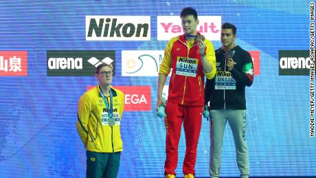 Mack Horton (left) refused to share the podium with Yang (center).