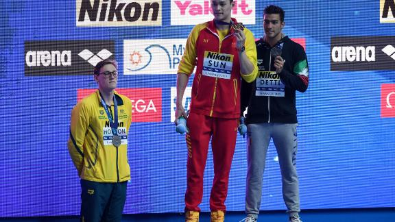 Silver medallist Australia's Mack Horton refuses to stand on the podium with gold medalist China's Sun Yang and bronze medalist Italy's Gabriele Detti after the final of the men's 400m freestyle event on July 21, 2019.