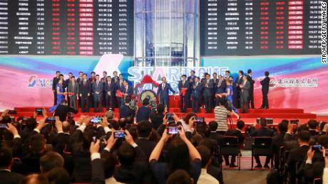 People take pictures during an opening ceremony of the Shanghai Stock Exchange's Sci-Tech Innovation Board in Shanghai on July 22, 2019. - Trading begins on July 22 on a new Nasdaq-style technology board in Shanghai that represents one of China's most significant market reforms, and a potential weapon in its growing tech rivalry with the United States. Twenty-five stocks debuted on the Shanghai Stocks Exchange's Sci-Tech Innovation Board -- dubbed the STAR Market -- in which listing and trading rules have been eased to help channel funding to start-ups. (Photo by STR / AFP) / China OUT        (Photo credit should read STR/AFP/Getty Images)