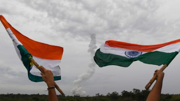 Flags fly as the Chandrayaan-2 launches in Sriharikota in the state of Andhra Pradesh on Monday.