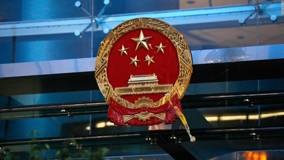 An egg thrown by a protester hits the National Emblem of the People's Republic of China at the Chinese Liaison Office in Hong Kong on July 21.