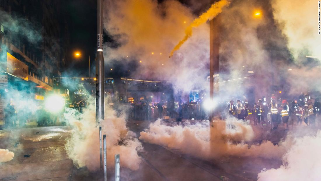 Police fire tear gas during an anti-extradition bill march on July 21.