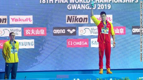 Silver medalist Mack Horton of Australia and gold medalist Sun Yang of China pose during the medal ceremony for Men's 400m Freestyle Final on day one of the Gwangju 2019 FINA World Championships at Nambu International Aquatics Centre on July 21, 2019 in Gwangju, South Korea.