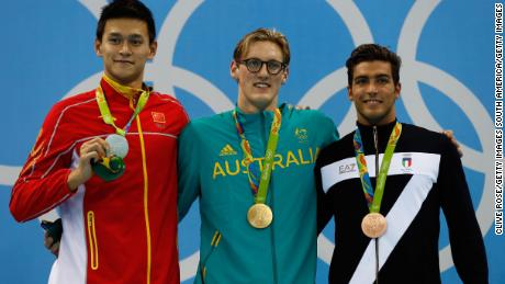Silver medalist Sun Yang of China, gold medal medalist Mack Horton of Australia and bronze medalist Gabriele Detti of Italy pose during the medal ceremony for the Final of the Men's 400m Freestyle on Day one of the Rio 2016 Olympic Games at the Olympic Aquatics Stadium on August 6, 2016 in Rio de Janeiro, Brazil.