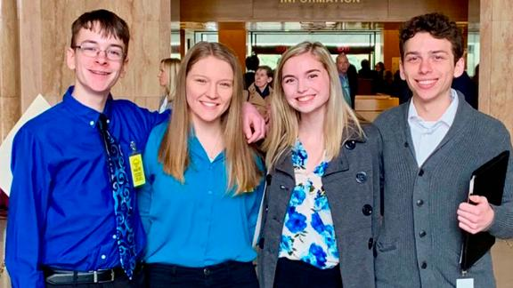 Sam Adamson, from left, Lori Riddle, Hailey Hardcastle and Derek Evans at the Oregon State Capitol in Salem.