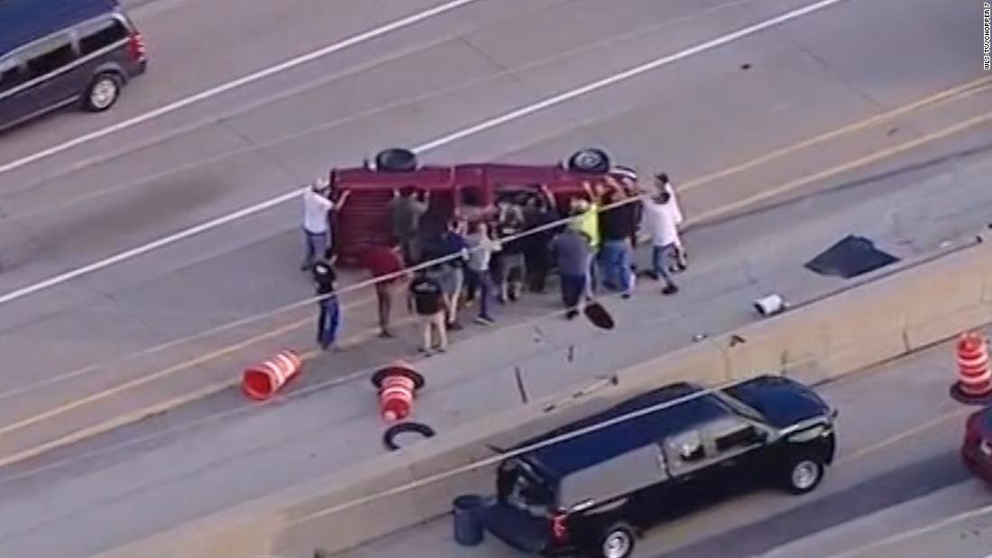 When a man's tire blew out and his car rolled over, a group of strangers saved him