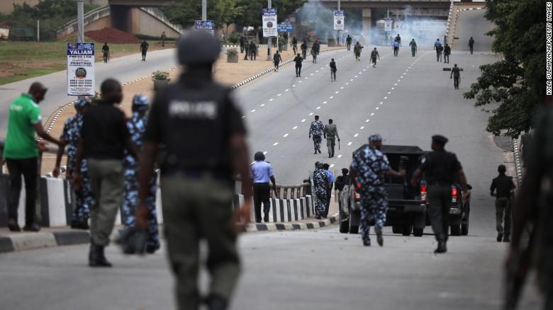 Nigerian police officers patrol in the streets of Abuja during clashes with members of the shiite Islamic Movement of Nigeria (IMN) on July 22, 2019.
