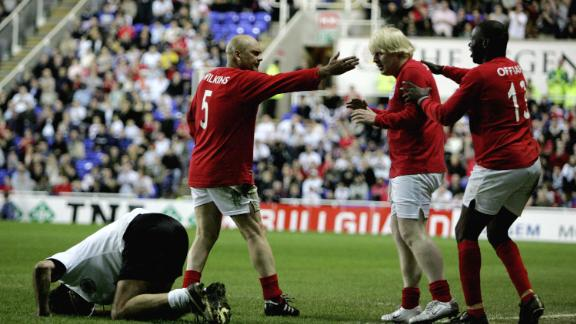 Johnson looks apologetic after fouling Germany's Maurizio Gaudino during a charity soccer match in Reading, England, in May 2006.