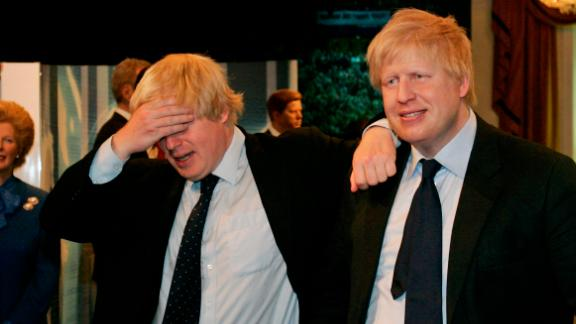 Johnson, left, poses with a wax figure of himself at Madame Tussauds in London in May 2009.