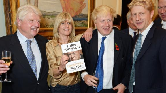 Johnson poses with his father, Stanley, and his siblings, Rachel and Jo, at the launch of his new book in October 2014. Stanley Johnson was once a member of the European Parliament.