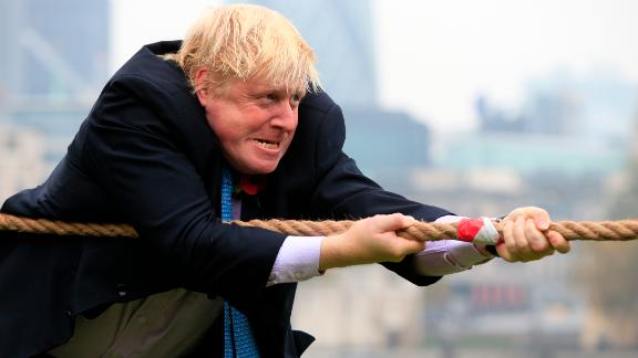 Johnson takes part in a charity tug-of-war  with British military personnel in October 2015.