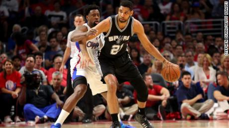 Tim Duncan controls the ball against DeAndre Jordan of the Los Angeles Clippers during the 2015 NBA Playoffs.