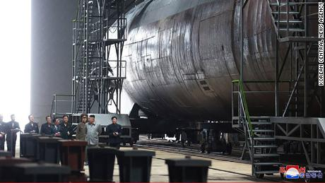 Kim is seen alongside what appears to be a sub in this image released by North Korean state media Tuesday.