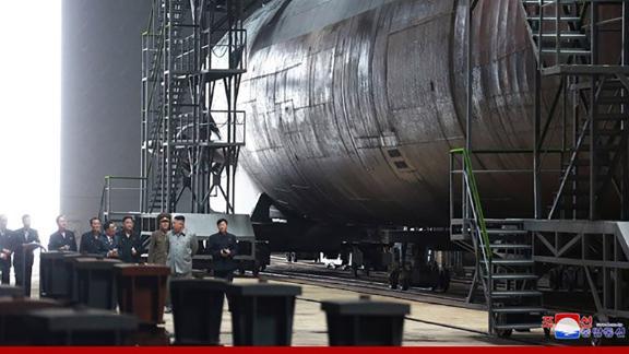 NK leader Kim Jong Un inspects a newly built submarine
