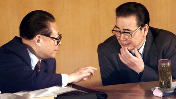 Chinese President Jiang Zemin (L) chats with Chairman of the National People's Congress Li Peng during the opening session of the Chinese People's Political Consultative Committee in Beijing in 2002.