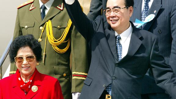 Li Peng (R), Chairman of the standing committee of the Chinese National People's Congress, is seen in 2002.