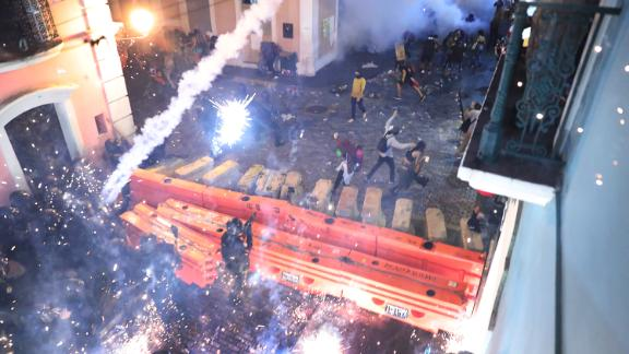 Police clash with protesters during demonstrations against Rosselló on Monday, July 22. The protests continued into Tuesday morning.