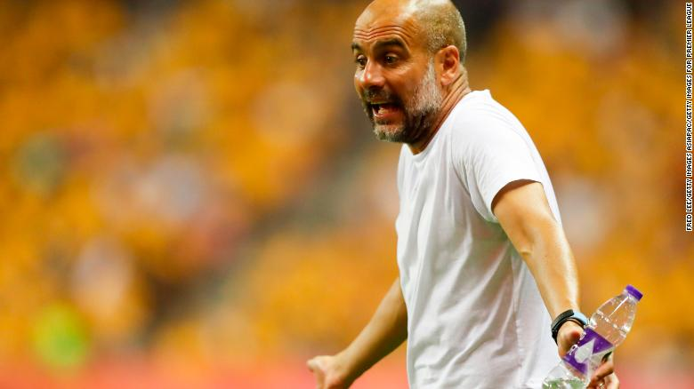 Guardiola reacts from the touchline during City's Premier League Asia Trophy final against Wolves.