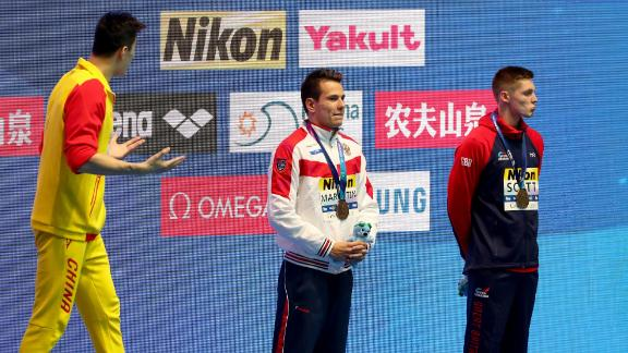 Gold medalist Sun Yang of China (left) and bronze medalist Duncan Scott of Great Britain (right) interact during the medal ceremony for the Men's 200m Freestyle Final.