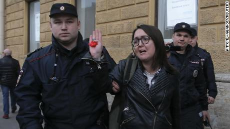 Police officers detain Yelena Grigoryeva during a rally held by LGBTQ activists in St. Petersburg in April.