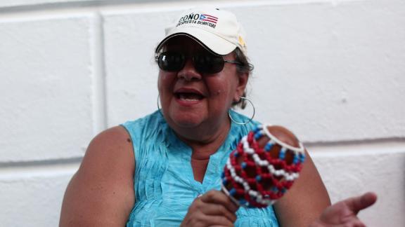 Elba Nazario, a retired teacher, protests near the governor