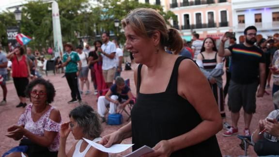 Cynthia Garcia Coll, a psychologist who teaches at the University of Puerto Rico at Rio Piedras, attends an anti-Rosselló street concert.
