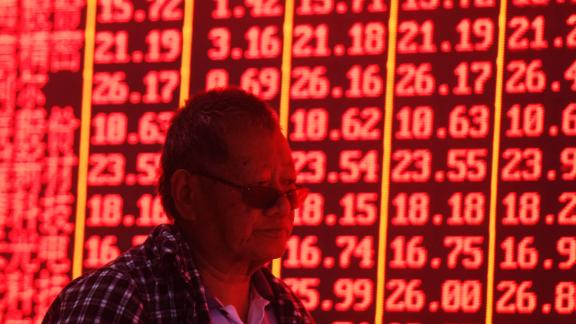 HANGZHOU, CHINA - JUNE 20: An investor watches the electronic board at a stock exchange hall on June 20, 2019 in Hangzhou, Zhejiang Province of China. Chinese shares rose on Thursday. The Shanghai Composite Index went up 69.32 points, or 2.38 percent, to close at 2,987.12. The Shenzhen Component Index rose 209.23 points, or 2.34 percent, to close at 9,134.96 points. (Photo by Long Wei/VCG via Getty Images)