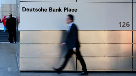 SYDNEY, AUSTRALIA - JULY 09: A man walks by Deutsche Bank signage on Phillip St on July 09, 2019 in Sydney, Australia. Deutsche Bank is axing an expected 18,000 jobs from its operations globally as part of a 7.4 billion euro ($A11.9 billion) overhaul of the German bank.  (Photo by Don Arnold/Getty Images)