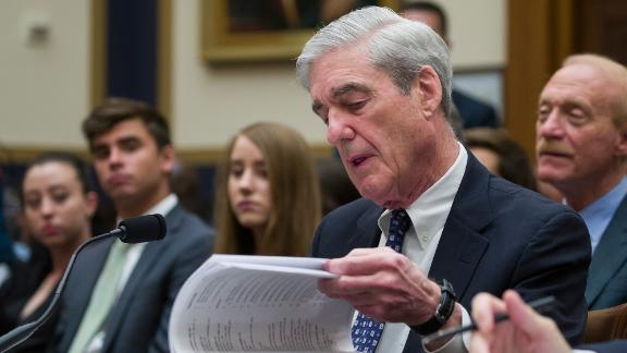 Former special counsel Robert Mueller checks a binder as testifies before the House Judiciary Committee hearing on his report on Russian election interference, on Capitol Hill, Wednesday, July 24, 2019, in Washington. (AP Photo/Alex Brandon)