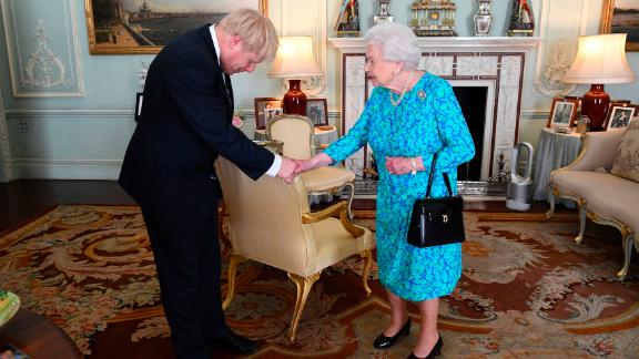 Britain's Queen Elizabeth II welcomes Johnson at Buckingham Palace, where she invited him to become Prime Minister and form a new government.