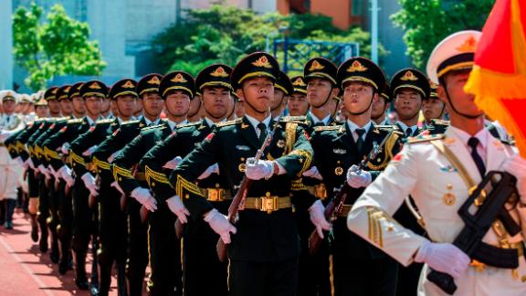 Soldiers of the PLA march during an open day at the Ngong Shuen Chau Barracks in Hong Kong on June 30.