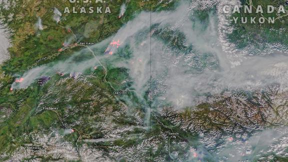 Satellite images show smoke billowing across Greenland and Alaska as wildfires ravage the region.