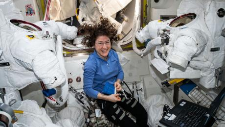 Expedition 60 Flight Engineer Christina Koch of NASA works inside the Quest joint airlock.