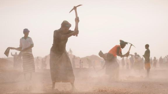 Land cultivation in Burkina Faso to prepare the earth for saplings.