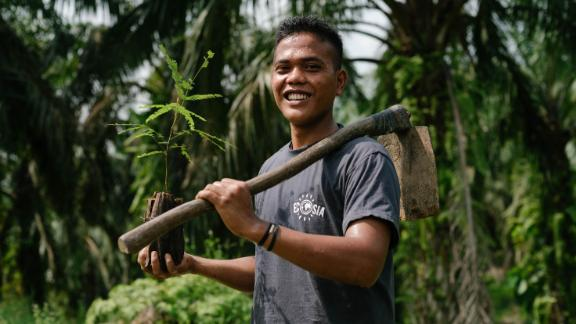 A tree planter working in association with Ecosia in Indonesia.
