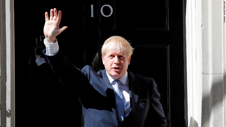 Britain's new Prime Minister, Boris Johnson, waves from the steps of No. 10 Downing Street after giving a statement in London on Wednesday, July 24.