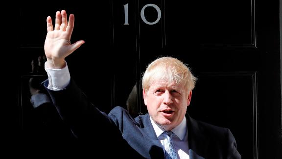 Britain's new Prime Minister, Boris Johnson, waves from the steps of No. 10 Downing Street after giving a statement in London on July 24.