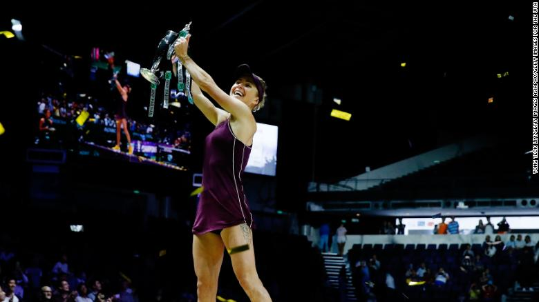 SINGAPORE - OCTOBER 28:  Elina Svitolina of the Ukraine poses with the Billie Jean King trophy after her win against Sloane Stephens of the United States during the Women's singles final match on Day 8 of the BNP Paribas WTA Finals Singapore presented by SC Global at Singapore Sports Hub on October 28, 2018 in Singapore.  (Photo by Yong Teck Lim/Getty Images for the WTA)