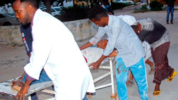 Medical workers help a civilian who was wounded in a suicide bombing in Mogadishu, Somalia, on Wednesday.