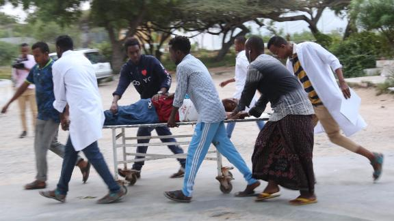 People carry a wounded person on a stretcher after a suicide attack in Mogadishu on Wednesday.