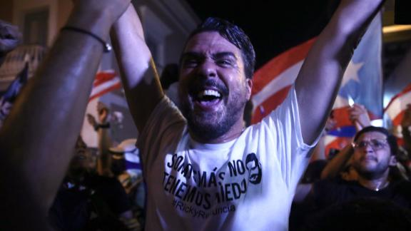 A demonstrator rejoices after Rosselló announced his resignation.