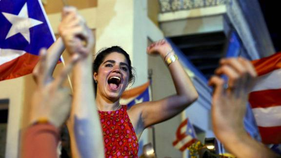 A woman celebrates near La Fortaleza.