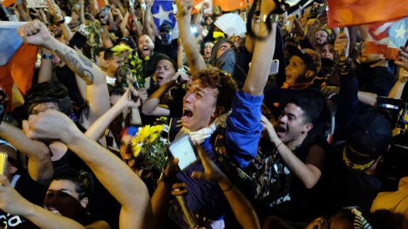 Protesters celebrate in Old San Juan, Puerto Rico, after Gov. Ricardo Rosselló announced that he will resign.