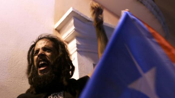 A Puerto Rican man cheers after the resignation of Rosselló.