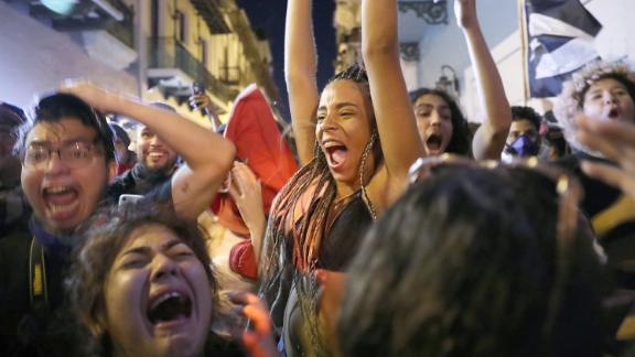 Jubilant demonstrators are seen in the streets of Old San Juan.