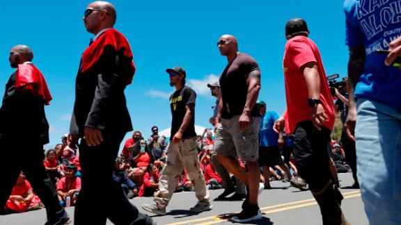 """Actor Dwayne """"The Rock"""" Johnson, third from right, walks with TMT opposition leader Kaho"""
