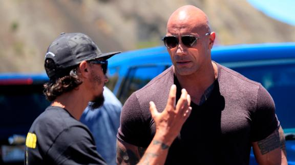 """Actor Dwayne """"The Rock"""" Johnson, right, talks with TMT opposition leader Kaho"""